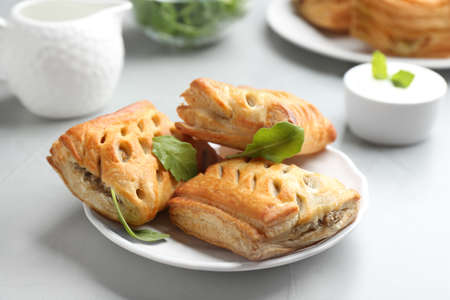 Fresh delicious puff pastry served on light table