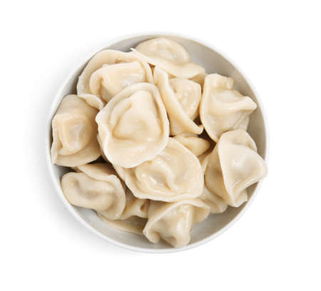 Tasty dumplings in bowl isolated on white, top view