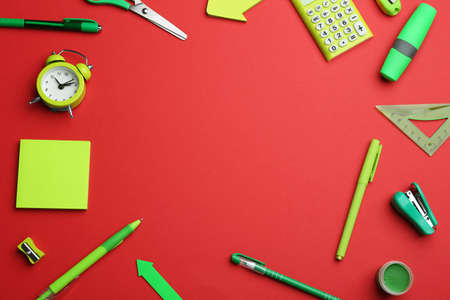 Frame of different bright school stationery on red background, flat lay. Space for text 版權商用圖片 - 129329199