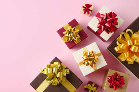 Flat lay composition with beautiful gift boxes on pink background. Space for text