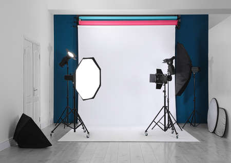 Photo studio interior with set of professional equipment