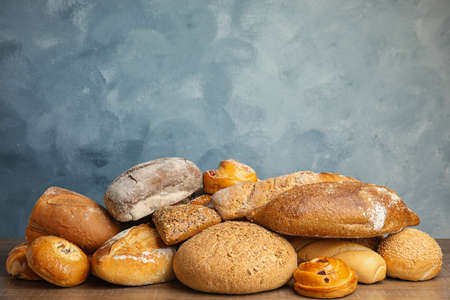 Fresh breads and pastries on wooden table Stock fotó