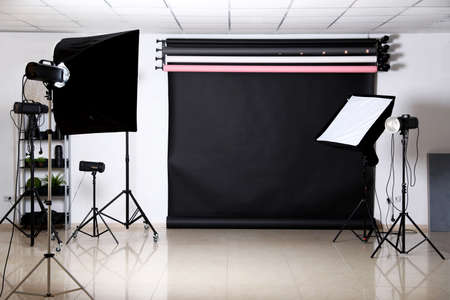 Photo studio interior with set of professional equipment Stok Fotoğraf - 129708036