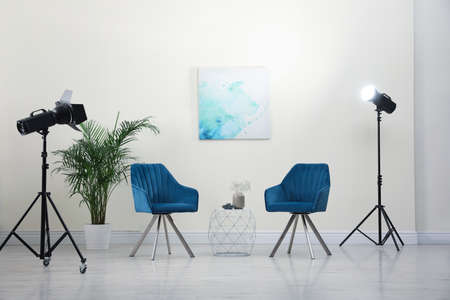 Professional photo studio equipment prepared for shooting living room interior