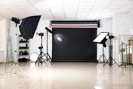Photo studio interior with set of professional equipment Stok Fotoğraf - 129708053