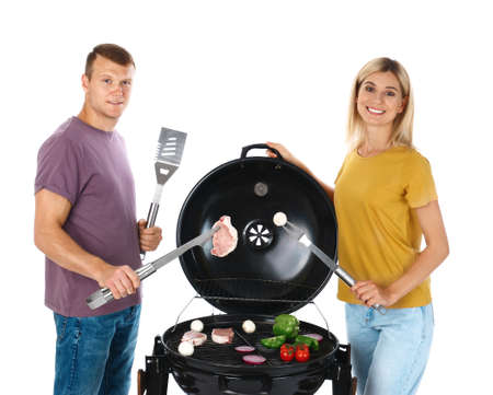 Happy couple cooking on barbecue grill, white background