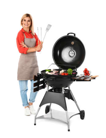 Woman in apron cooking on barbecue grill, white background