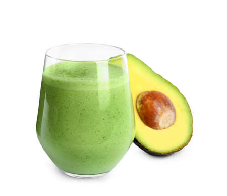 Glass of tasty smoothie and avocado on white background
