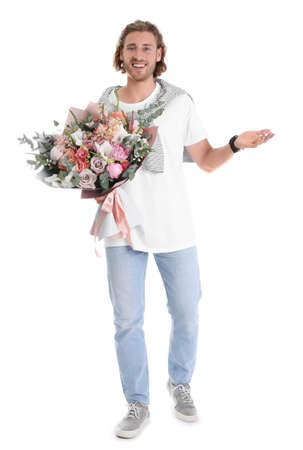 Young handsome man with beautiful flower bouquet on white background