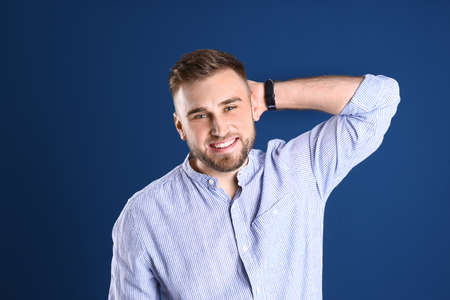 Portrait of handsome happy man on color background