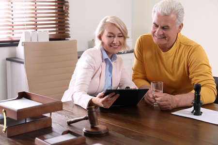 Female notary working with client in office Imagens