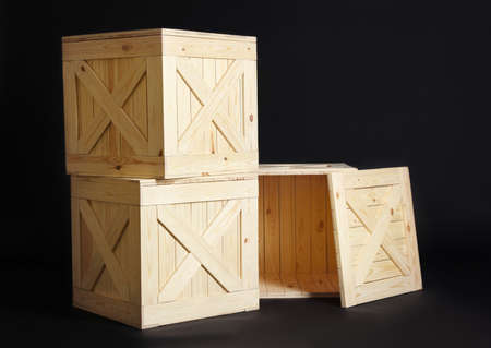 Group of wooden crates on black background Foto de archivo - 129525153
