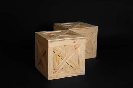 Pair of wooden crates on black background Foto de archivo - 129527850