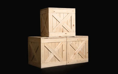 Group of wooden crates on black background Foto de archivo - 129527931