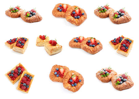 Set of fresh delicious puff pastries with sweet berries on white background 写真素材 - 129531647