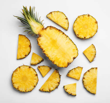 Composition with raw cut pineapple on white background, top view 写真素材 - 129531875