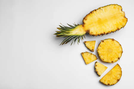 Composition with raw cut pineapple on white background, top view 写真素材 - 129531861