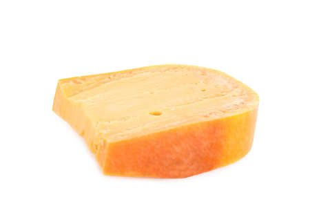 Piece of tasty mimolette cheese isolated on white 写真素材 - 129531884