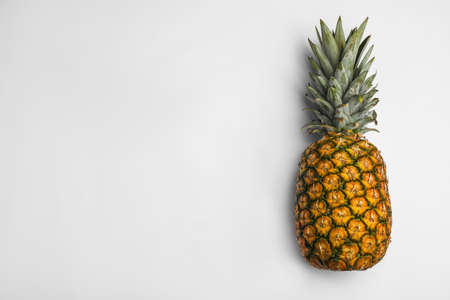 Tasty whole pineapple with leaves on white background, top view 写真素材 - 129532272