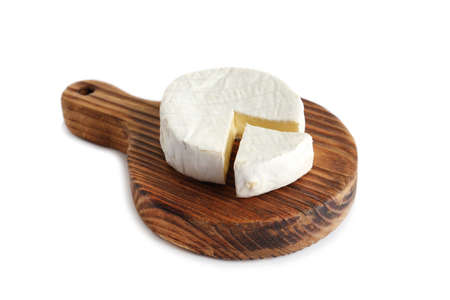 Wooden board with brie cheese on white background 写真素材 - 129532266
