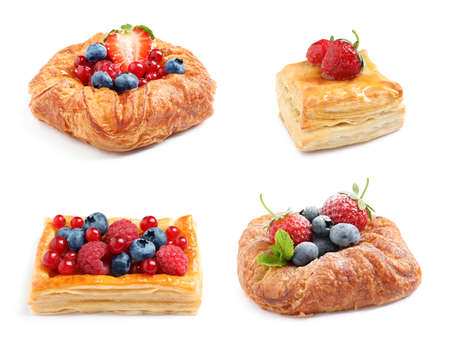 Set of fresh delicious puff pastries with sweet berries on white background 写真素材 - 129532294