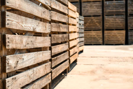 Old empty wooden crates outdoors on sunny day. Space for text Foto de archivo - 129527569