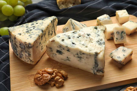 Board of delicious blue cheese with snacks on table 写真素材