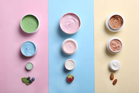 Flat lay composition with jars of body cream on color background 写真素材 - 129531684