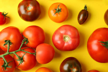 Flat lay composition with fresh ripe tomatoes on yellow background 写真素材 - 129532025