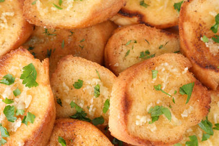 Slices of delicious toasted bread with garlic and herbs, closeup 写真素材 - 129532024