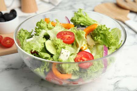 Tasty fresh Greek salad on white marble table, closeup 写真素材