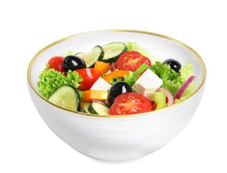 Tasty fresh Greek salad on white background 写真素材 - 129532058