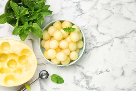 Flat lay composition with melon balls on white marble table, space for text 写真素材 - 129532199