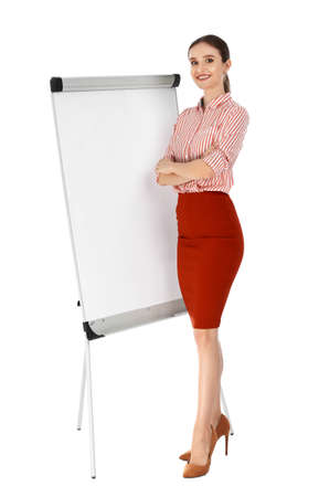 Professional business trainer near flip chart board on white background. Space for text 写真素材