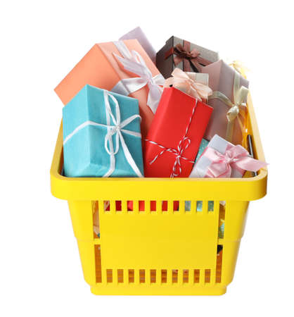 Shopping basket full of gift boxes on white background Imagens