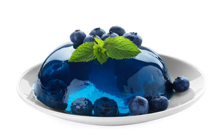 Delicious jelly with blueberries and mint on white background Imagens