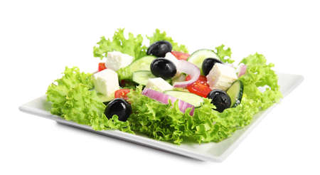 Tasty fresh Greek salad on white background Imagens
