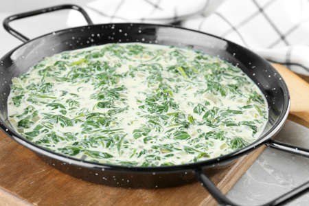 Tasty spinach dip on grey marble table