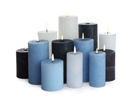 Set of different color candles on white background Imagens