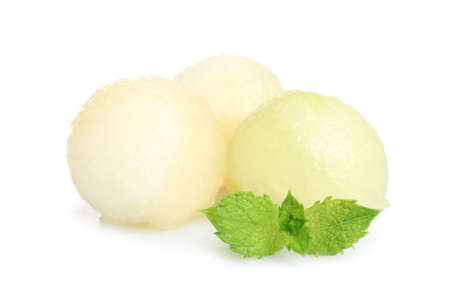 Juicy sweet melon balls with mint on white background Imagens