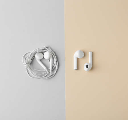 Flat lay composition with different earphones on color background