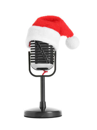 Retro microphone with Santa hat isolated on white. Christmas music concept Stockfoto