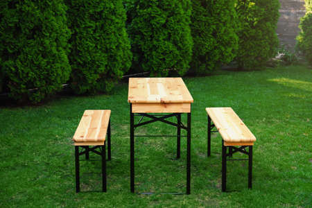 Wooden picnic table with benches in park