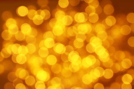 Blurred view of Christmas lights on dark background