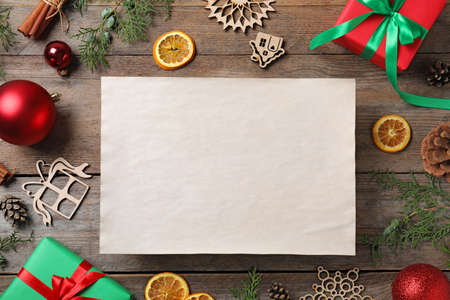 Blank paper with space for text and Christmas decor on wooden background, flat lay. Letter to Santa Claus