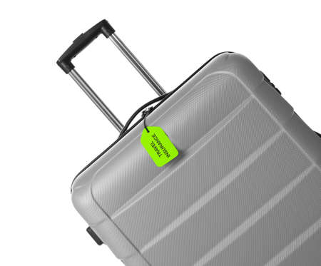 Grey suitcase with TRAVEL INSURANCE label on white background Stok Fotoğraf