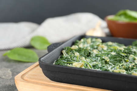 Tasty spinach dip on table, closeup view