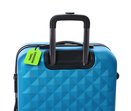 Blue suitcase with TRAVEL INSURANCE label on white background