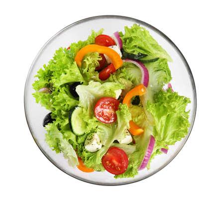 Tasty fresh Greek salad on white background, top view