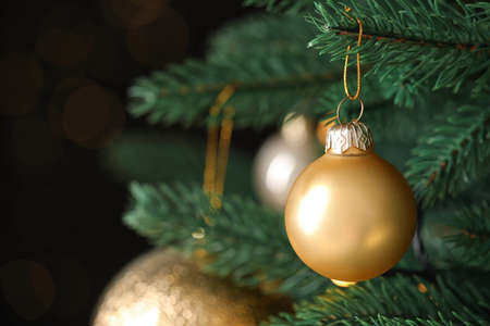 Beautiful Christmas tree with festive decor on blurred background, closeup